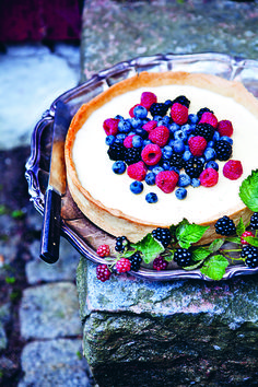 Be inspired by modern Swedish recipes including this berry tart with The Summer Table by Lisa Lemke