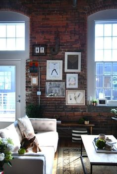 Living room, couch, brick wall, pictures