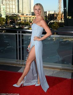 Cutting a rug! Julianne Hough, 28, wowed on the red carpet in a strapless, sky blue frock with miniature buckle details down one side