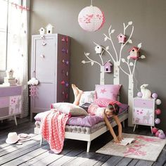 Pink + purple + painted trees on the wall = the perfect girls' bedroom