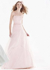 You will feel pretty in pink in this beautiful organza over satin gown!  Strapless gown features gorgeous eye-catching pink organza over satin fabric.  Sparkling sash adnores waist.  Sweep train. Sizes 0-14.  Available in select stores.  Fully lined. Back zip. Imported polyester. Dry clean.
