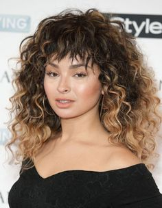 A fringe cut into curly hair can be challenging but Ella demonstrates that rolling with it is the only approach. Her choppy bangs look great with her full-bodied signature style. Lesson learnt: don't try too hard!