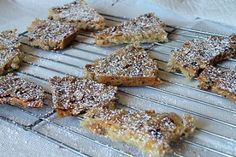 This recipe for Lemon Almond Cookie Brittle is baked as one big cookie and then broken into pieces just like a brittle. Cookie Brittle Recipe, Cookie Recipes, Belgian Food, Belgian Recipes, Big Cookie, Recipe Girl, Lemon Cookies, Candy Making, Lemon Recipes