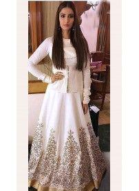 Latest Designer White Designer Lehenga By Kmozi..  http://www.kmozi.com/bollywood-replica/online-shopping-bollywood-actress-lehenga-choli/latest-designer-white-designer-lehenga-by-kmozi-1317