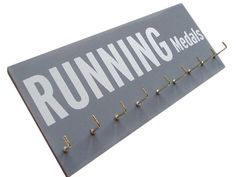 Display your Pride and Joy with Running Medal display. $28.00, via Etsy.