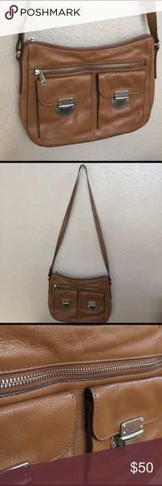 Fossil Leather Crossbody NWOT Leather! Adjustable strap. Pockets throughout.  New. Fossil Bags Crossbody Bags