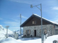 Meteo station at lake Serrù, valle Orco, Alps, Italy (lago Serrù, valle Orco, NW Alps, Italy)