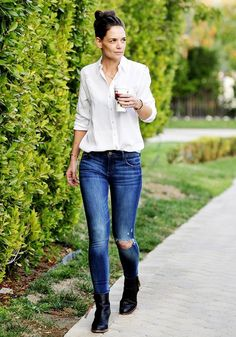 On Holmes:The Blue Shirt Shop blouse; DL1961 Florence Instasculpt Skinny Jeans($178) in Seymour. Similar Style: Equipment Slim Signature Double Flap Pocket Blouse($214) in White.