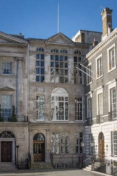 The London Library's narrow facade and entrance at 17th century 14 St. James's Square, private subscription lending library founded 1941, now expanded into a series of adjacent buildings and 20th century extensions holding a collection of over 1 million in 17 miles of bookshelves
