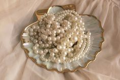"""Long ones, short ones in between strands, pearls can be fun - even fake pearls in multi colours to quote Diana Vreeland """" style is personal"""" have fun!"""