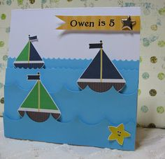 "Cute sail boats, and I like the waves.  She has used foam squares to add depth to the ""waves""."