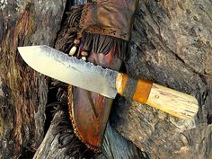 "Frontier Belt/Camp Knife. With spalted maple scales and brass pins. Hand-forged from an antique file. 10 1/4"" overall. Filework. A beautiful hand made knife with a rawhide wrap over leather sheath, decorated with a deer hide fringe and trade beads."
