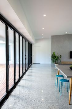 Polished concrete floors and glass bi-fold doors seamlessly connect the indoors with the outdoors at our Hideaway home. Polished Concrete Kitchen, Concrete Kitchen Floor, Polished Concrete Flooring, Terrazzo Flooring, Concrete Floors In House, Floor Design, House Design, Building A House, New Homes