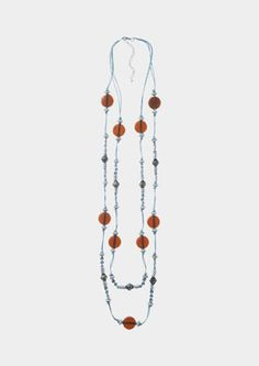 Glass and metal beads on a waxed cotton cord.