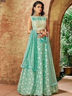 Look pristine and stylish by wearing this amazing sea green color tissue fabric thread embroidery party wear lehenga choli. Pair this beautiful lehenga with the matching jewelry and classy clutch. Choli Designs, Lehenga Designs, Blouse Designs, Dress Designs, Party Wear Lehenga, Bridal Lehenga, Simple Lehenga, Green Lehenga, Gold Lehenga