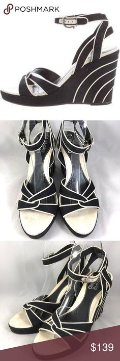 "SALVATORE FERRAGAMO Canvas Wedge Sandal Black 8 Black canvas Salvatore Ferragamo platform sandals with creme leather trim, covered wedge heels and Gancini buckle closures at ankle straps.  Heel: 4"" Platform: 1"" Open toe Made in Italy  Condition: Pre-owned. Great shape. Please refer to pictures. Size: 8 Insole measures 10.1"" Salvatore Ferragamo Shoes Sandals"