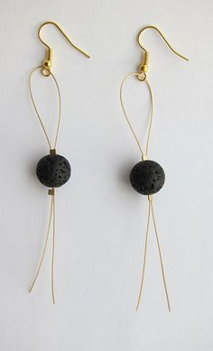 Lava earrings of a golden wire with golden ear hooks. The earrings are just about 10 cm (4 inches) long.