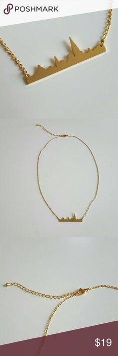 """New York City Skyline Necklace This lovely 14k gold plated necklace has a beautiful detailed New York City Skyline of the skyscraper building. Brand new and unused. This pendent is 1.5"""" long and 1cm wide on a chain that is 19"""" Great with your favorite shirt and jeans. Other great accessories in my closet. Jewelry Necklaces"""