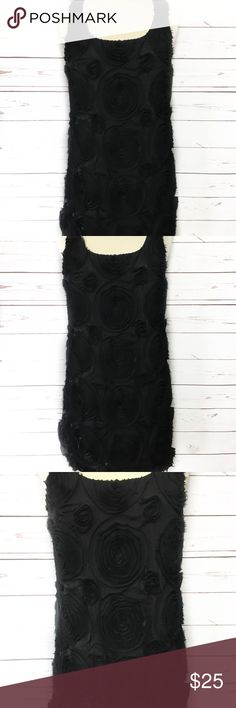 Romeo & Juliet Couture Black Rosettes Dress Romeo & Juliet black slip on dress with chiffon rosettes the dress has a black metallic shimmer. GUC materials: 100% polyester Romeo & Juliet Couture Dresses Mini