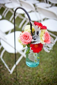 Blue Mason Jars - Coral Flowers - Gerber Daisies - Garden Roses - Laura Ross Photography - Rustic Outdoor Wedding