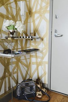 Designer Casey Debois' Manhattan Apartment – Love the swipes of gold paint!