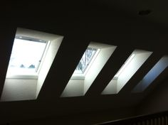 We retrofit four VELUX curb mounted skylights complete with venetian blinds to replace old plastic skylights.