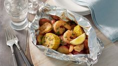 This foil pack version of the Southern classic low country shrimp boil brings together andouille sausage, corn on the cob and baby red potatoes.