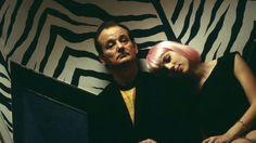 Bill Murray's yellow camo tee + Scarlett Johansson's pink wig + zebra stripe wallpaper at a karaoke bar