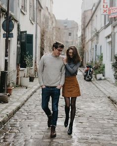 Strolling down the streets of Paris arm in arm. #paris #montmartre #lovers
