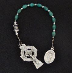 One decade Catholic Rosary, Celtic Crucifix, St Patrick / St Bridget reversible medal Green cats eye beads.