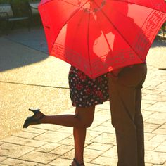 Hide the kiss with umbrella. Whoops (;