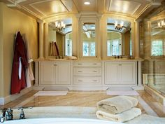 Custom dual vanities provide plenty of storage in this luxurious bathroom.