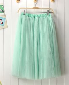 mint green tulle skirt.