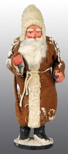 "9"" tall brown coat Father Christmas candy container, German  Photo courtesy of Dan Morphy Auctions"
