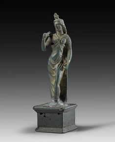 Bronze figure of Isis-Fortuna on antique basis. Attractive patina, reattached on base in antiquity using a large lead lump. Roman Imperial Period, 2nd - 3rd century A.D.