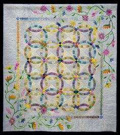 Flowers for my Wedding Ring by Eileen Buel (New York).  Judge's Choice Award, 2014 Vermont Quilt Festival.  Design by Judy Niemeyer Quilting.