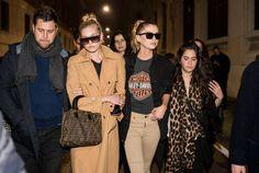 Model Elsa Hosk wearing a beige coat and Stella Maxwell wearing a Harley Davidson tshirt outside Moschino during Milan Fashion Week Fall/Winter...