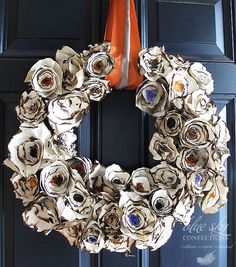 Wreath using paper plates, coffee and cookie sprinkles.  I think I might use plastic spiders inside the flowers.
