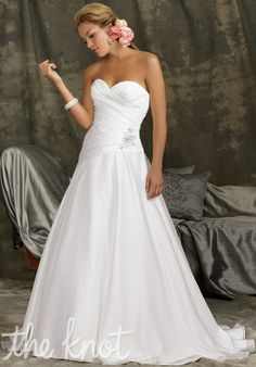 Gown features beading. Available with zipper or lace-up back. Reflections by Jordan Style M990