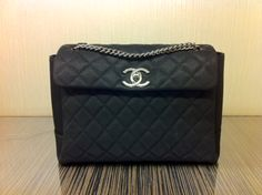 Chanel Black Lady Pearly Medium Flap Bag.  Next purchase
