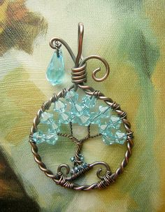"""""""Little Blue Bird""""  This pendant was made with blue, sparkly blue Crystals and oxidized copper wire to give it a beautiful finished look. I added glass seed beads to the roots for an extra splash of color. It measures almost 2 inches tall (including the bail) and approximately 1 inch across at the widest area. Very tiny! =]  This original and uniquely crafted bail (the top piece) gives off a sense of playfulness while still being elegant, making it perfect for just about any occasion."""