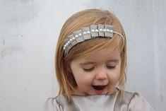Cute, not just for kids The tutorial is here:  http://theadventuresofroryandjess.blogspot.com/2011/01/pleated-headband-tutorial.html