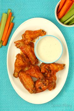 Baked Buffalo Chicken Wings are finger lickin' good (and save you money on take out)