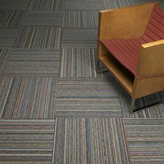Stringworks II Modular Carpet: Each tile is a unique, random, combination of yarn colors made entirely of post-production nylon that in the past might have been sold and downcycled. Available on Infinity modular backing with pre-consumer recycled content.