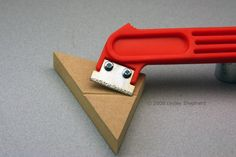 Easy Way to Make Channels for Dollhouse Wiring Using a Graut Saw: A grout saw or grout rake can quickly make channels in MDF for installing a dolls house round wire electrical system.                                                                                                                                                     More