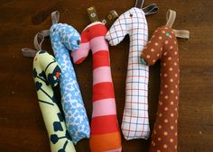 We have a few babies in the family that need gifts so I made each of them a Soft Rattle from Lotta Jansdotter's book Simple Sewing for Baby...