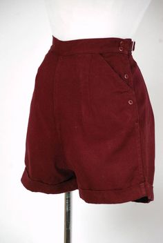 These late 1930s shorts are a delight in deep plum-burgundy hue - the color is honestly even better than the photos. These cheerful shorts are tailored perfectly, with a wide high waistband and flat darted front. They have two working pockets and crisp pressed cuffs. Buckles at the back allow you to cinch the shorts more snugly. This garment closes with a series of side snaps and has the cutest label. ✂-----Measurements  Waist: 27.5, can be cinched to 25 Hips: 40 Length: 15.5 Inseam: 1.75…