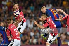 Barcelona's French defender Jeremy Mathieu heads the ball to score a goal beside…