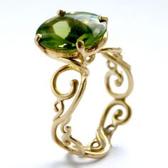 Scroll #Ring In 18 Ct #Gold Set With #Peridot by Serena Fox http://www.fldesignerguides.co.uk/engagement-ring-designer/serena-fox