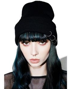 Cold Pierce Ring Beanie cuz yer a bad gurl no matter the weather. This badazz knit beanie features a black, thick knit construction and a rollover cuff with three pierced embellishments on it.